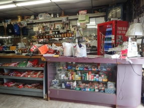A shop selling ham, car tyres and standard lamps.